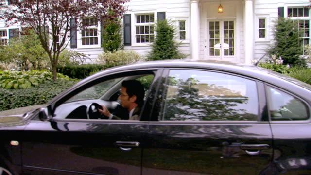 Man leaving for work, tilt down