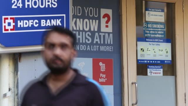 Man leaving HDFC Bank Ltd in Mumbai India on Saturday April 21 2018