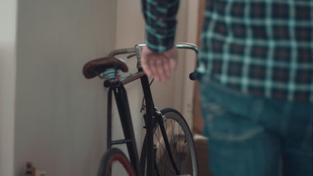 Man leaving home with bike