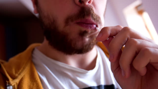 man licking lollipop - human tongue stock videos & royalty-free footage