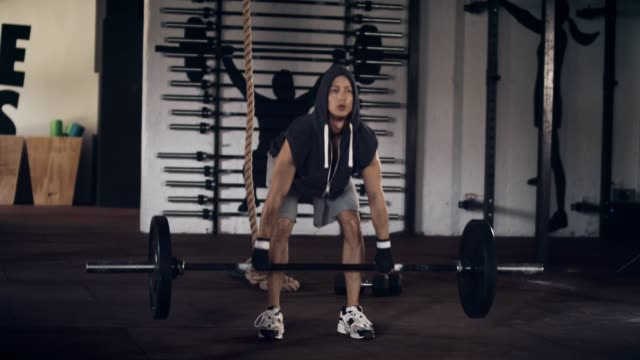 man lifting barbell in gym - cross training stock videos & royalty-free footage