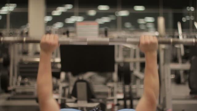 man lifting benchpress slowmo - human limb stock videos & royalty-free footage