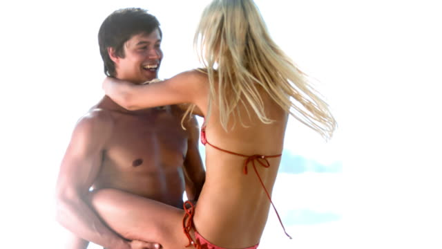 Man lifting his girlfriend in slow motion