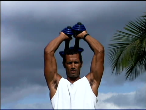 man lifting weights outdoors - one mid adult man only stock videos & royalty-free footage