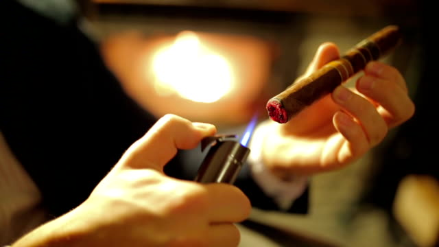 man lighting his cigar - sigaro video stock e b–roll