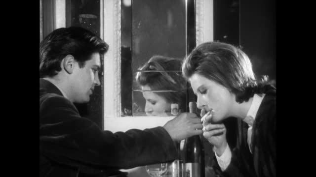 man lights woman's cigarette in restaurant; 1963 - wine glass stock videos & royalty-free footage