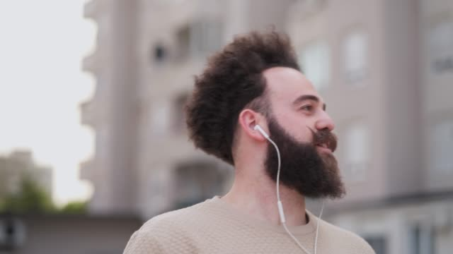 man listening music and exploring city - cool attitude stock videos & royalty-free footage