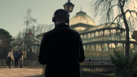 man listening to music - madrid stock videos & royalty-free footage