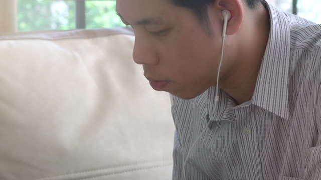 man listening via headphones - human ear stock videos and b-roll footage