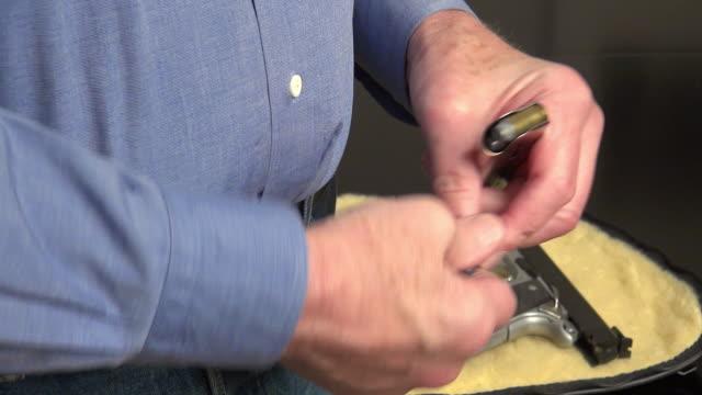 man loading a gun - handgun stock videos and b-roll footage