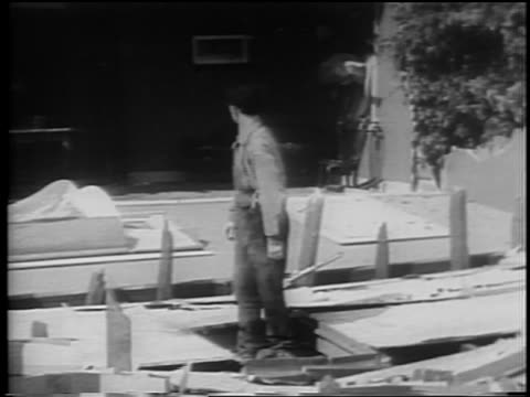man looking around + running from collapsed house / feature - 1928 stock videos & royalty-free footage