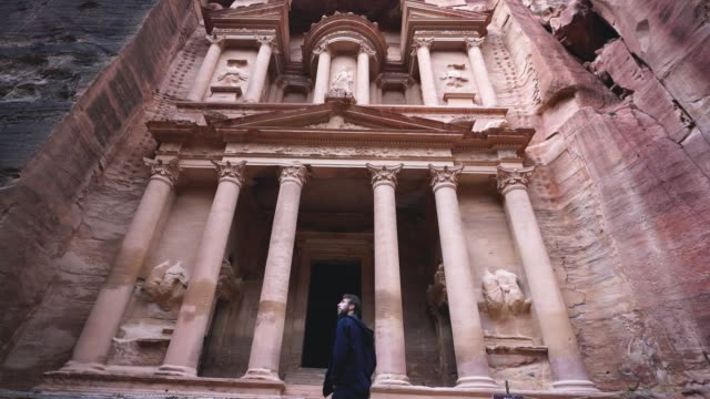 man looking at al-khazneh in petra - ancient stock videos & royalty-free footage