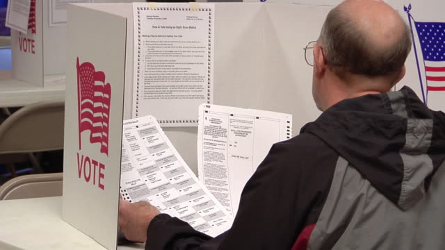 ms, man looking at ballot paper sitting in voting booth, st. marys, ohio, usa - voting booth stock videos & royalty-free footage