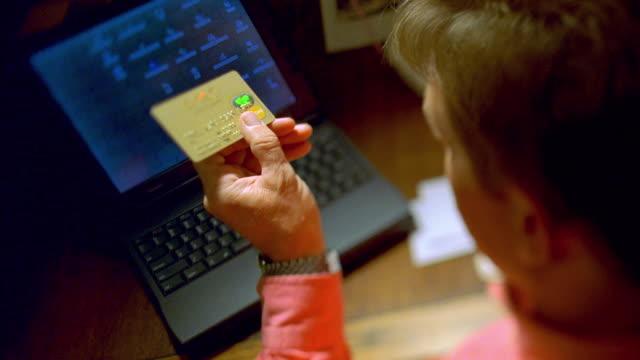 cu td man looking at credit card / canyon lake, texas, usa - canyon lake stock videos & royalty-free footage