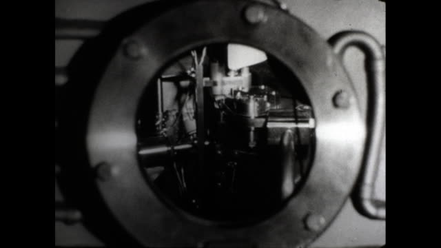 man looking at inside of machine through hole camera zooms into the hole in machine tubes and wires inside machine - man and machine stock videos & royalty-free footage