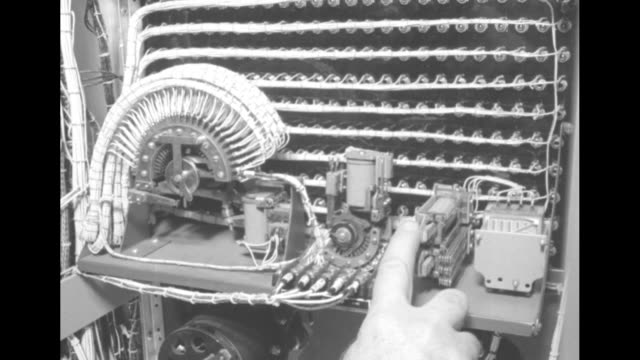 man looking at machine with film reels turning on it / tangle of electrical wires in circuit board tilt down to components at bottom of board /... - fuse box stock videos and b-roll footage