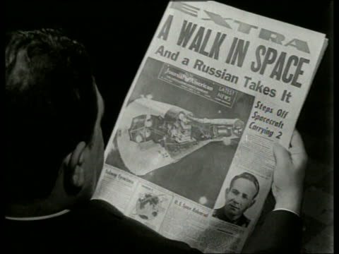 "man looking at newspaper ""a walk in space"" / first man to walk in space / sound - 1965 stock videos & royalty-free footage"