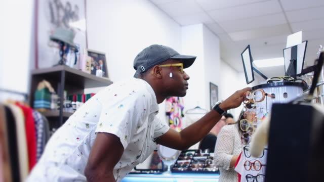 Man Looking at Retro Eyeglasses in Vintage Store