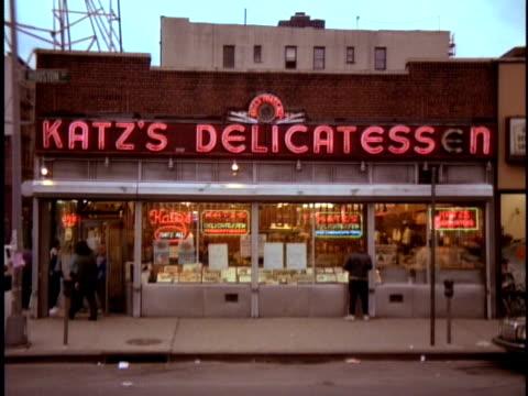 1990 MS Man looking in window of Katz's delicatessen / New York City, New York, USA