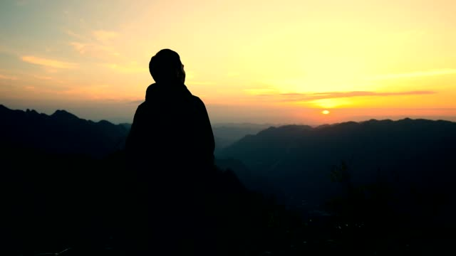 man looking mountains sunset - hill stock videos & royalty-free footage