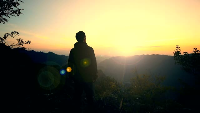 man looking mountains sunset - on top of stock videos & royalty-free footage