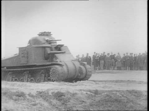 stockvideo's en b-roll-footage met man looking out front window of m3 lee tank with turrets moving / group of men standing in front of tank / tank driving in demonstration for crowd /... - maryland staat