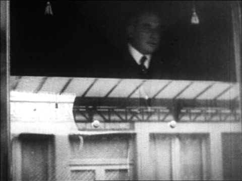 b/w 1929 man looking out of window talking / nyc / newsreel - one mature man only stock videos & royalty-free footage