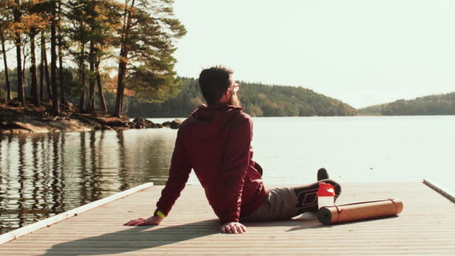 man looking out over a lake - mindfulness stock videos & royalty-free footage