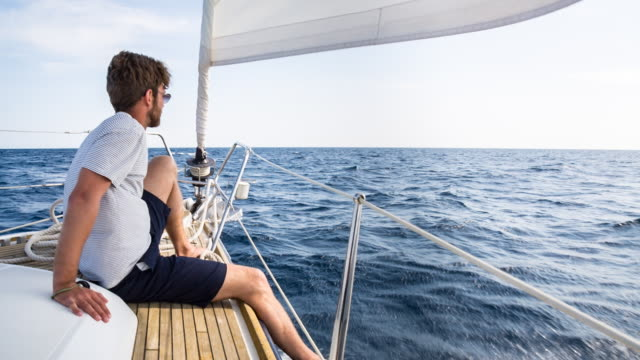 MS man looking out over mediterranean sea on modern sailing yacht