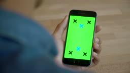 Man looking ta Mobile Green screen