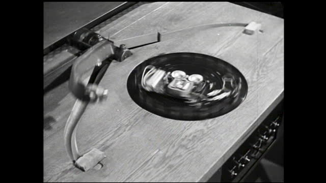 man looking through microscope-like machine; man watching telephone spin around on machine - 1940 1949 stock videos & royalty-free footage