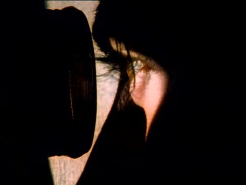 ecu, man looking through peephole in doors, slovenia - peeking stock videos & royalty-free footage
