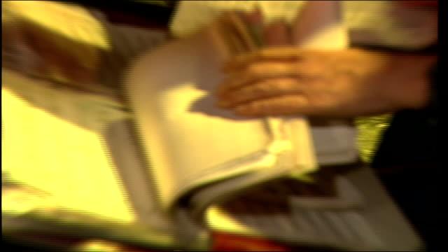 man looking through sheet music - sheet music stock videos & royalty-free footage