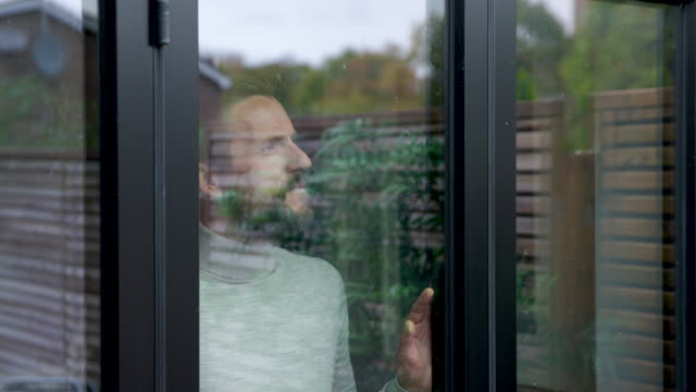 man looking through window - one mature man only stock videos & royalty-free footage