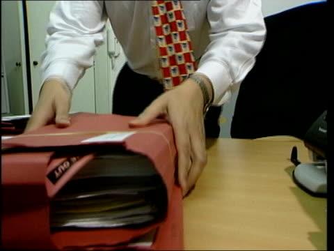 international lib man looking thru asylum seekers file - amnesty international stock videos & royalty-free footage
