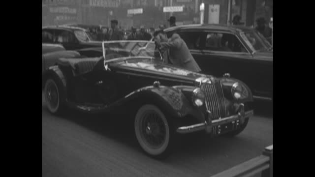 man looks at 1955 mg tf at the salon de automobile in the grand palais, parc des exhibition - grand palais stock videos & royalty-free footage