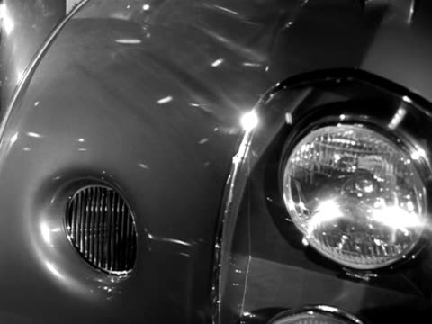 a man looks at a specially fitted out daimler at the earls court motor show - motor show stock videos and b-roll footage