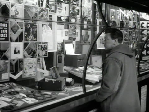 man looks at the window displays of a record shop. - 1950 1959 stock videos & royalty-free footage