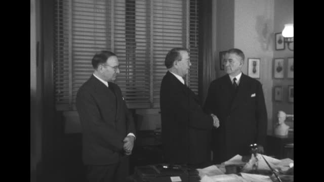man looks on as sen kenneth mckellar and alben barkley shake hands at photo opportunity probably held after barkley was reelected senate majority... - alben w. barkley stock videos and b-roll footage
