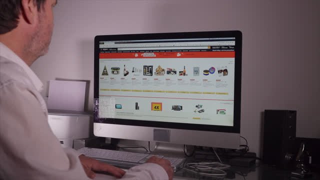 man looks on his computer for promotions on online merchants during black friday, december 04, 2020 in paris, france. following a meeting with the... - ブランド名点の映像素材/bロール