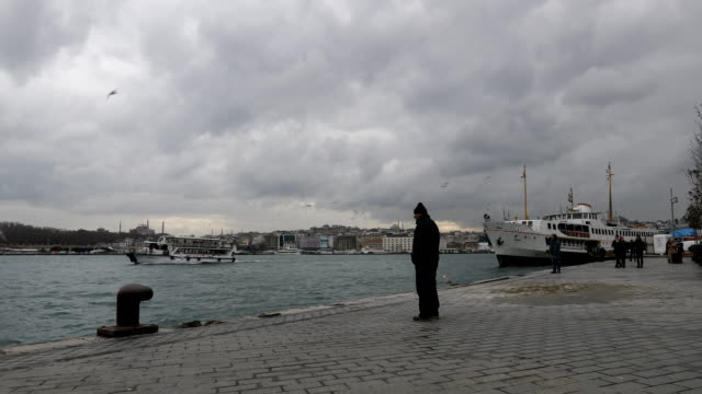 A man looks out of the Bosphorus strait from Karikoy ferry terminal on February 16 2016 in Istanbul Turkey