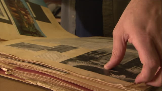 a man looks through antique documents. - album fotografico video stock e b–roll