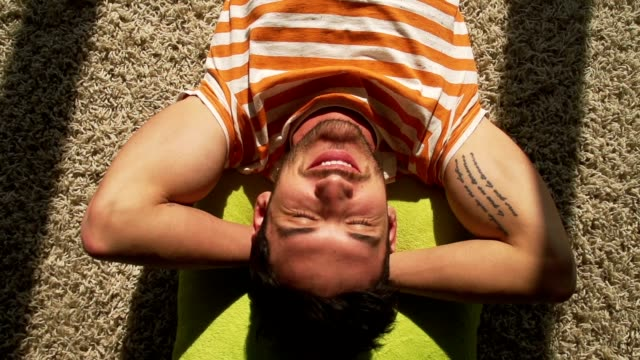 man lying down on the floor - lying down stock videos & royalty-free footage