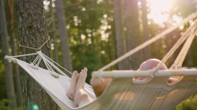 man lying in a hammock - hammock stock videos & royalty-free footage