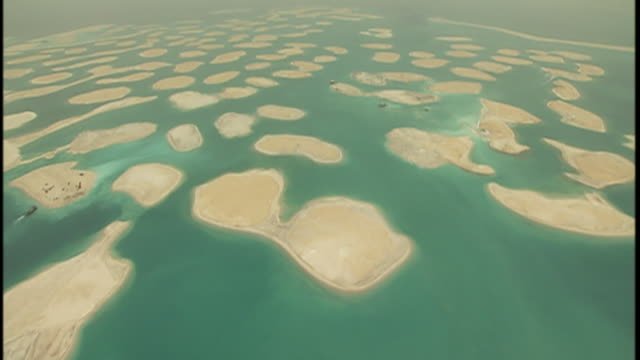 man made islands rise from the floor of the persian gulf. - island stock videos & royalty-free footage