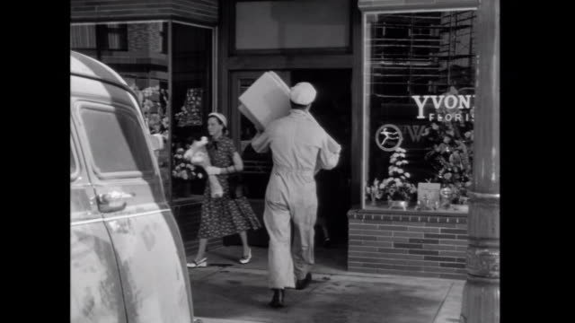 1952 A man makes a delivery to a florist