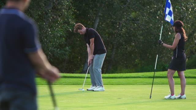 Man makes a putt