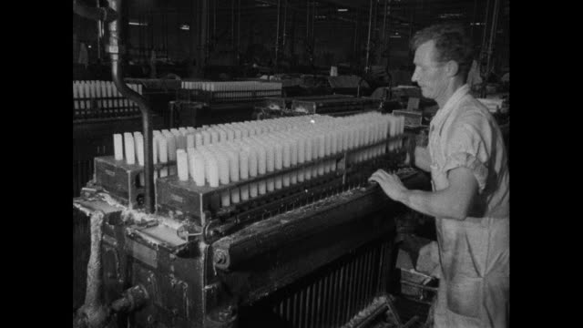 man makes candles in factory; 1965 - moulding a shape stock videos & royalty-free footage
