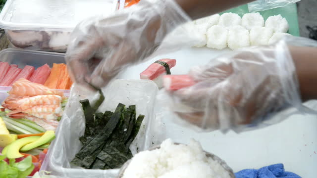 man makes sushi in a food stall - ko samui stock videos and b-roll footage