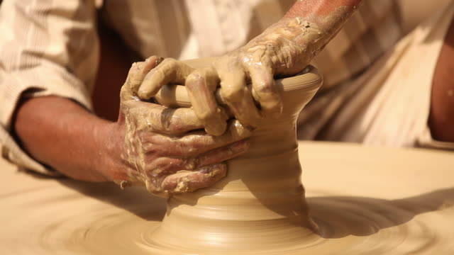 man making a earthen pot on a pottery wheel, faridabad, haryana, india - pottery stock videos & royalty-free footage